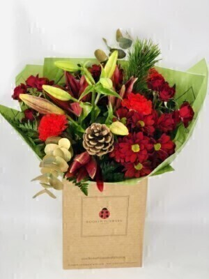 Christmas Cracker Handtied Bouquet: Booker Flowers and Gifts