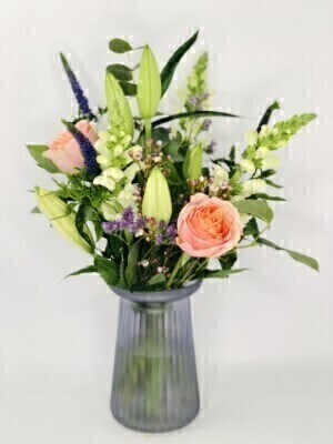 Hatbox of Flowers in WaterHand arranged by our florists into a luxury hatboxTo give you the best occasionally we may make substitutesOur flowers backed by our 7 days freshness guaranteeApproximate dimensions 36cmx24cmThis product is available for UK deliveryThis beautiful arrangement of flowers in pink and purple in a lilac vase is a delightful choice for someone special.Featuring white LA lilies blue iris pink antirrhinums 2 large-headed white roses lilac statice pink limonium  hand arranged with mixed foliage and presented in a corrugated lilac glass vase. Plus all our bouquets and plants have a small wooden ladybird hidden in somewhere so dont forget to spot the ladybird on our social media pages!Liverpool Flower DeliveryWe offer advanced booking flower delivery same day flower delivery 3 hour Flower delivery guaranteed AM PM or Evening Flower Delivery and we are now offering Sunday Flower Delivery.The best florist in LiverpoolCome to Booker Flowers and Gifts Liverpool for your Beautiful Flowers and Plants if you really want to spoil we also have a great range of Local Gin Wines Champagne Balloons Vases and Chocolates that can be delivered with your flowers. To see the full range see our extras section. You can trust Booker Flowers and Gifts can deliver the very best for you.