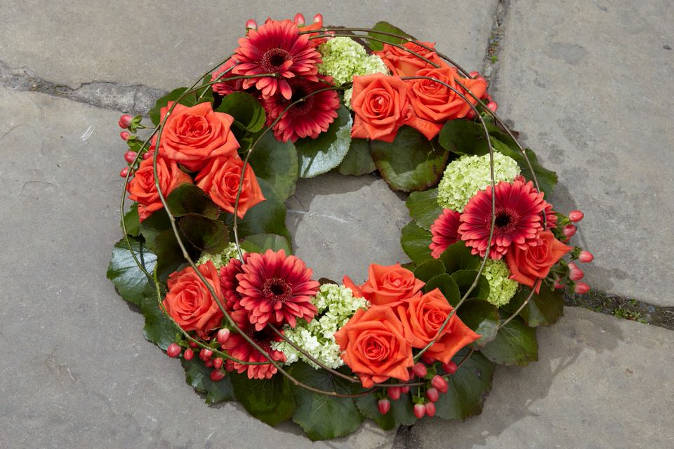 Natural Orange Rose and Germini Wreath: Booker Flowers and Gifts
