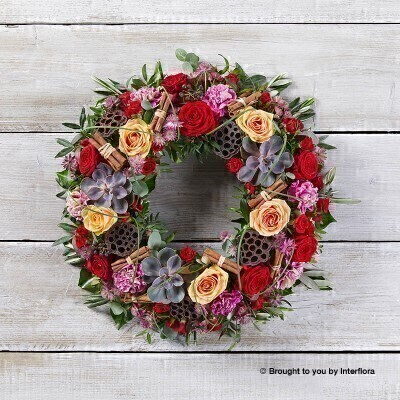 Santa Baby Festive Door Wreath: Booker Flowers and Gifts