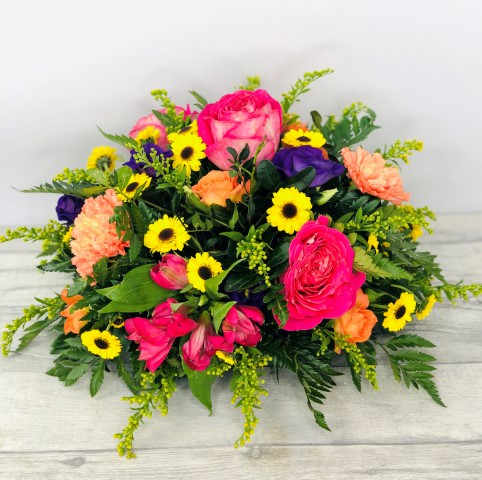 Vibrant Table Arrangement: Booker Flowers and Gifts