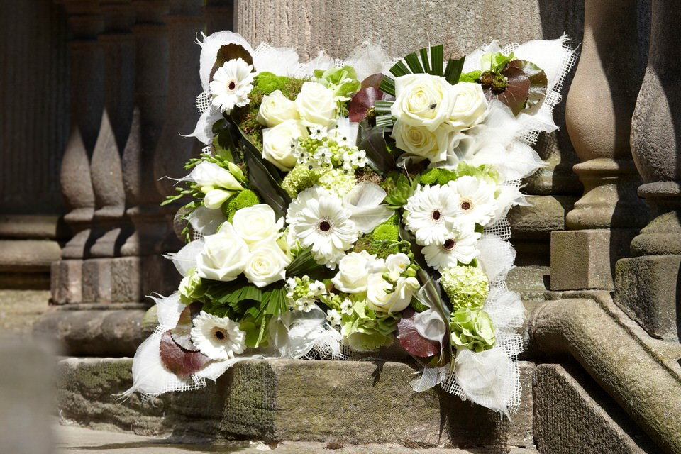 White and Black Cushion Funeral Tribute: Booker Flowers and Gifts